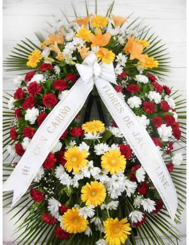 corona de flores con claveles, margaritas y lilium