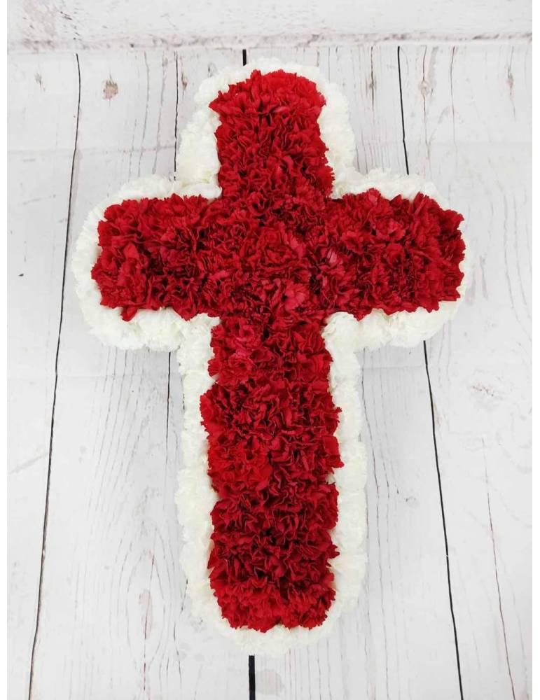 cruz funeraria con flores